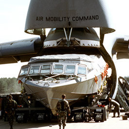 Navy Mark V SOC being unloaded from C5 transport plane